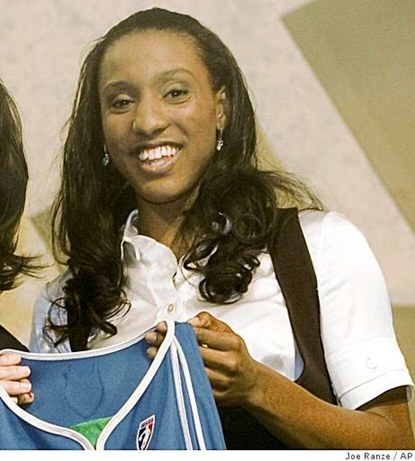 WNBA President Donna Orender, left, and Stanford's Candice Wiggins  hold up a jersey after Wiggins was selected third overall in the first round of the WNBA draft by the Minnesota Lynx, Wednesday, April 9, 2008, in Palm Harbor, Fla. (AP Photo/Joe Ranze) Photo: Joe Ranze, AP
