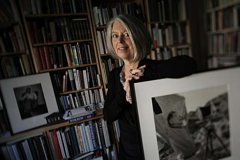 Sandra S. Phillips, curator of Photography at SFMOMA, is seen in her home on Wednesday, October 13, 2010 in San Francisco, Calif., with some of the photographs from her personal collection. Photo: Lea Suzuki, The Chronicle