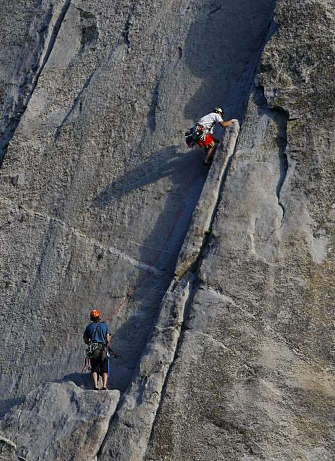 Rock climbers Yuji Hirayama, top, of Japan and Hans Florine of Lafayette, Calif., bottom, climb up the Nose Route of El Capitan in Yosemite National Park on September 29, 2008. They were on a practice climb as a warm up to a later attempt to break their own speed climbing record of 2 hours, 43 minutes and 33 seconds. Photo: Michael Maloney, The Chronicle