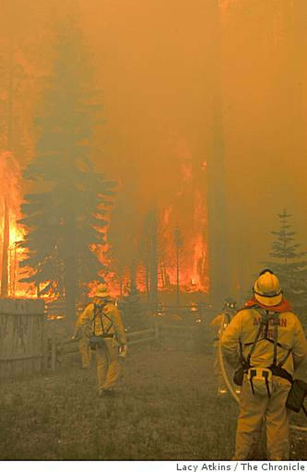 Firefighters fight the Angora Fire on June 26, 2007 in Lake Tahoe, Calif.