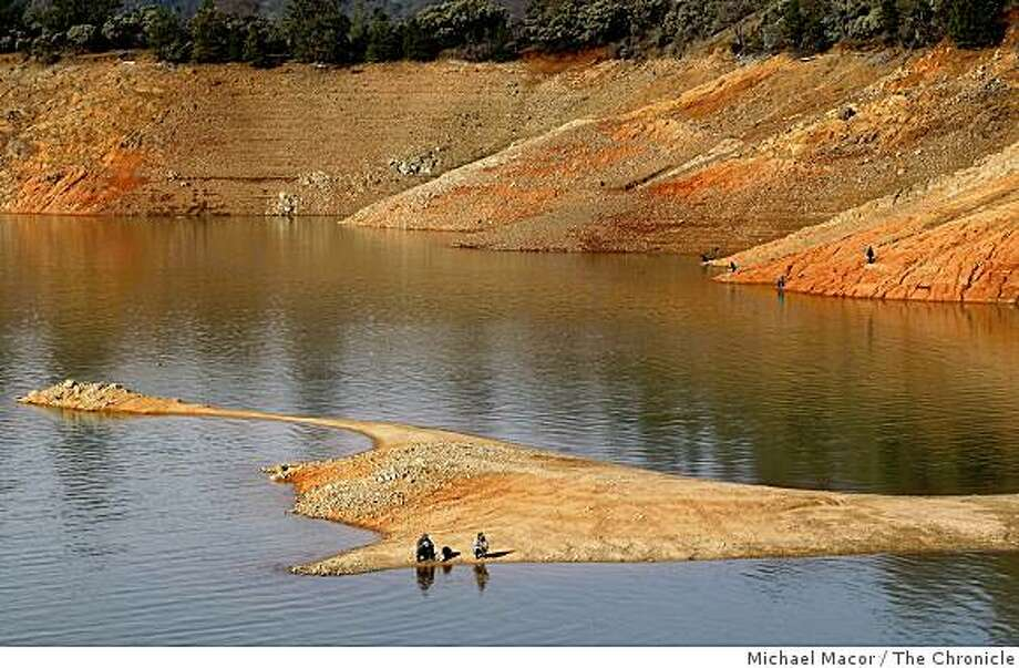 In this 2009 file photo, the water level sits at 71 feet below normal at Shasta Lake in Northern California. A new state report stated Californians will have to deal with worsening droughts in the coming decades as a result of climate changes. Photo: Michael Macor, The Chronicle