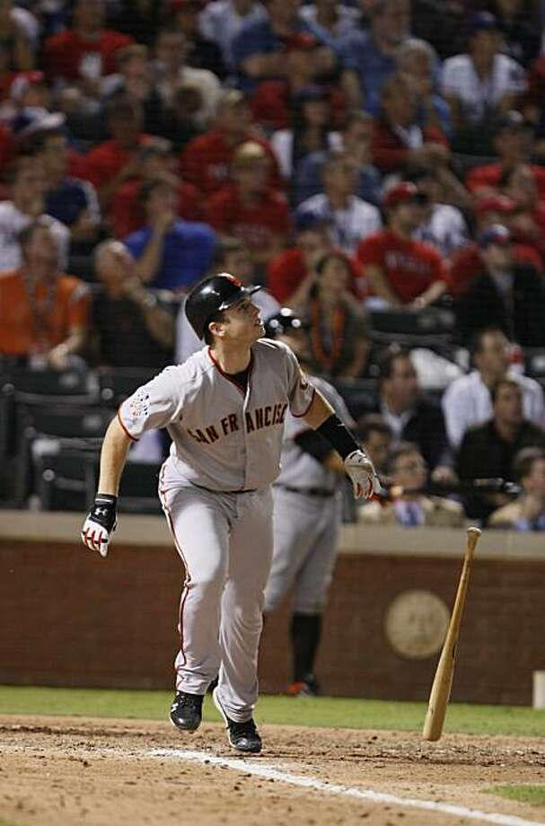 San Francisco Giants catcher Buster Posey watches his eighth inning homer in Game 4 of the World Series against the Texas Rangers on Sunday. Photo: Lance Iversen, San Francisco Chronicle