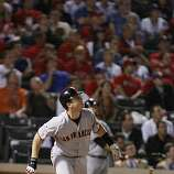 San Francisco Giants catcher Buster Posey watches his eighth inning homer in Game 4 of the World Series against the Texas Rangers on Sunday.