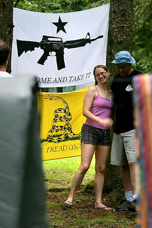 "** ADVANCE FOR SUNDAY, JULY 26 **In this  June 26, 2009 photo,  campers stand  near flags that state, ""Don't Tread on Me,"" and, ""Come and Take It"" at the Porcupine Freedom Festival 2009 in Lancester, N.H. (AP Photo/Cheryl Senter) Photo: Cheryl Senter, AP"