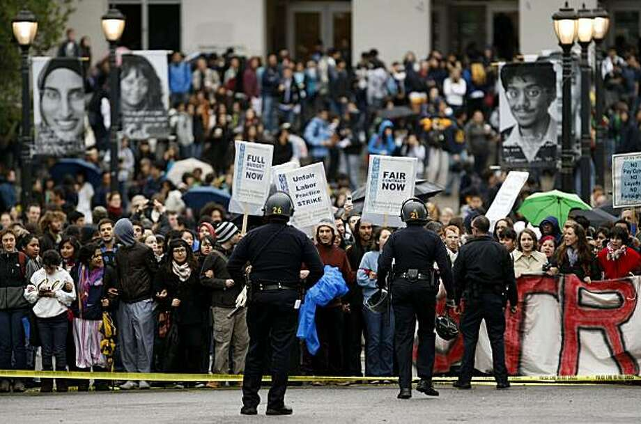 UC Berkeley students rally in front of Wheeler Hall against proposed pay cuts, layoffs, and tuition increases on Friday morning. Photo: Michael Macor, The Chronicle