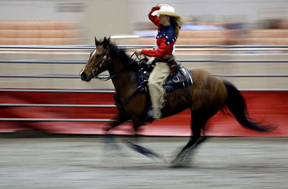 Careena Lapuz from Woodside Ca is a member of the Mountain Shooter who will perform Saturday at 3pm at the 62nd annual Grand National Rodeo, Horse and Stock Show that starts Friday through April 14th at The Cow Palace. Photo: By Lance Iversen, The Chronicle