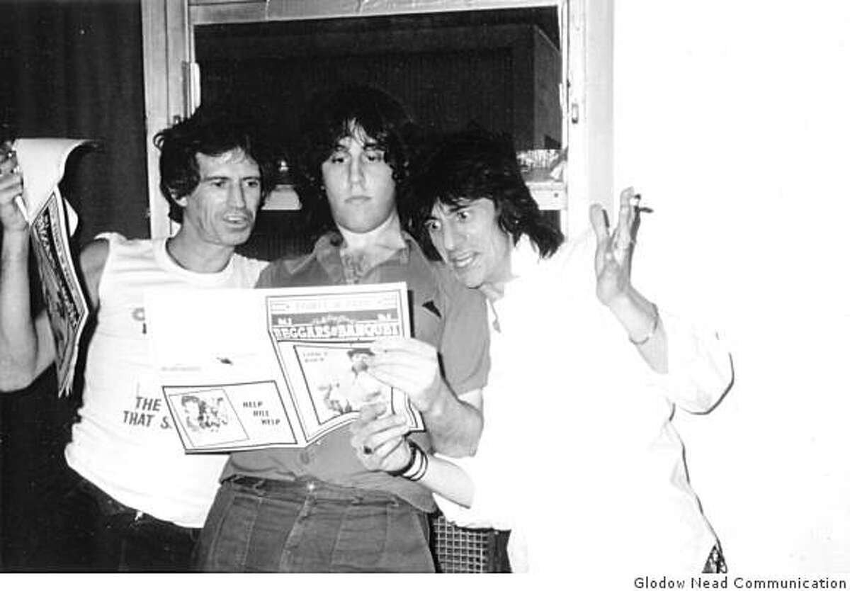 Bill German (middle), at age 22, with Keith Richards and Ron Wood of the Rolling Stones reading the newest issue of Bill?s newsletter Beggars Banquet.