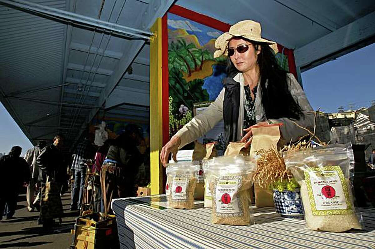 Robin Koda, at the Alemany Farmers Market, on Saturday Jan. 31, 2009, in San Francisco, Calif., where she displays her bags of Heirloom Varietal rice she produces at her farm in the San Joaquin Valley.