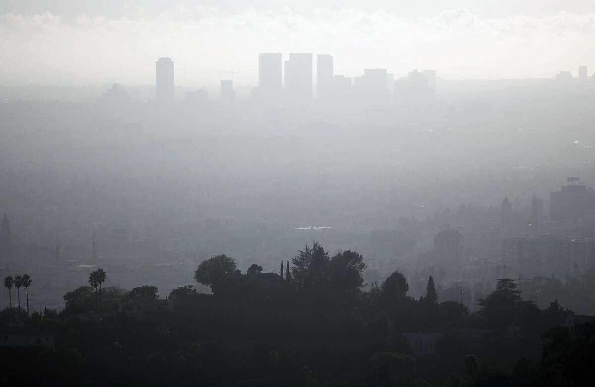 A view of downtown Los Angeles,California is seen on a smoggy afternoon, 02 November 2006. Due to the city's geography making it susceptible to atmospheric inversion as well as the heavy reliance on automobiles as a major source of transportation, the city suffers from air pollution in the form of smog.