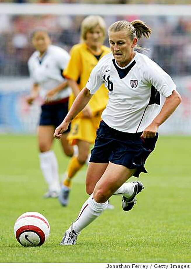 PORTLAND, OR - JULY 10: Tiffeny Milbrett #16 of the United States dribbles the ball while playing her 200th career game against Ukraine during an international friendly match on July 10, 2005 at Merlo Field in Portland, Oregon.Milbrett later would score her 100th international goal as the United States defeated Ukraine 7-0. (Photo by Jonathan Ferrey/Getty Images) Photo: Jonathan Ferrey, Getty Images