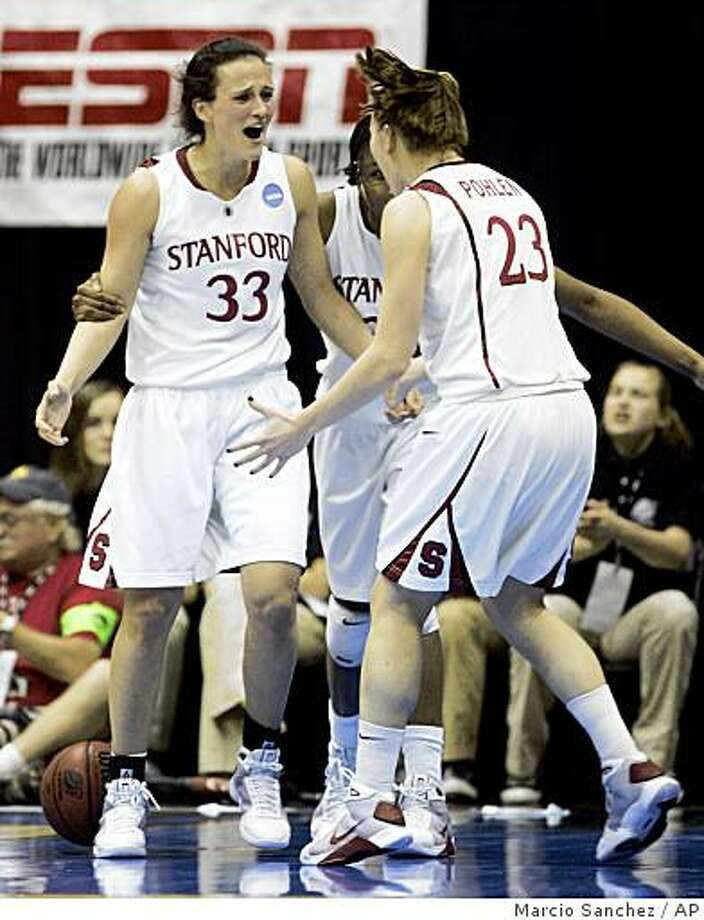 Stanford forward Jillian Harmon, left, guard Jeanette Pohlen, right, and forward Nnemkadi Ogwumike, center, celebrate in the second half against Ohio State during a women's NCAA tournament regional championship college basketball game in Berkeley, Calif., Saturday, March 28, 2009. Stanford beat Ohio State 84-66. Photo: Marcio Sanchez, AP