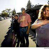 Brenda Bueno (R) and others watch the funeral procession for Oakland, Calif., Police Officer Ervin Romans as it travels  on Diablo Road in Danville, Calif., on Friday, Mar. 27, 2009, enroute to a memorial service in Oakland for Romans and two other officers who were killed in the line of duty in Oakland on Saturday, Mar. 21.