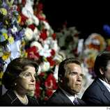 OAKLAND, CA - MARCH 27:  U.S. Sen. Diane Feinstein, California Gov. Arnold Schwarzenegger and Lt. Governor John Garamendi attend the  public memorial service for slain Oakland Police Officers Sgt. Mark Dunakin, 40; John Hege, 41; Sgt. Ervin Romans, 43; and Sgt. Daniel Sakai, 35, on March 27, 2009 in Oakland, California. Thousands of police officers from across the country joined other mourners to pay their respects to the four officers  killed in the line of duty March 21 following a traffic stop of a fugitive parolee. (Photo by Michael Macor-Pool/Getty Images)