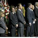 From left: Sen. Barbara Boxer, Sen. Dianne Feinstein, Gov. Arnold Schwarzenegger, John Garamendi, Attorney General Jerry Brown and Mayor Ron Dellums attend the funera forl four slain Oakland police officers at the Oracle Arena on Friday, March 27, 2009 in Oakland, Calif. Thousands of mourners gathered with the families of four slain Oakland police officers for a joint funeral Friday that drew law enforcement officers from around the world. (AP Photo/Jane Tyska, POOL)