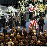 The flag draped caskets of Oakland Police Officers Sgt. Mark Dunakin, 40; John Hege, 41; Sgt. Ervin Romans, 43; and Sgt. Daniel Sakai, 35, are carried by law enforcement officers into Oracle Arena on Friday, Mar. 27, 2009, in Oakland, Calif. Thousands of officers and firefighters from around the nation and overseas along with mourners turned out for Friday's funeral for the four veterans. The four officers were shot in the line of duty Saturday, March 21, the biggest single day, gun-related loss of life for law enforcement since four federal agents died 15 years ago during a raid on the Branch Davidian cult in Waco, Texas. (Michael Macor / San Francisco Chronicle, Pool)