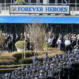 Thousands of police officers from across the country and Bay Area residents filled the Oracle Arena on Friday March 27, 2009 in Oakland, Calif., for the funeral of four Oakland police officers shot and killed in the line of duty.