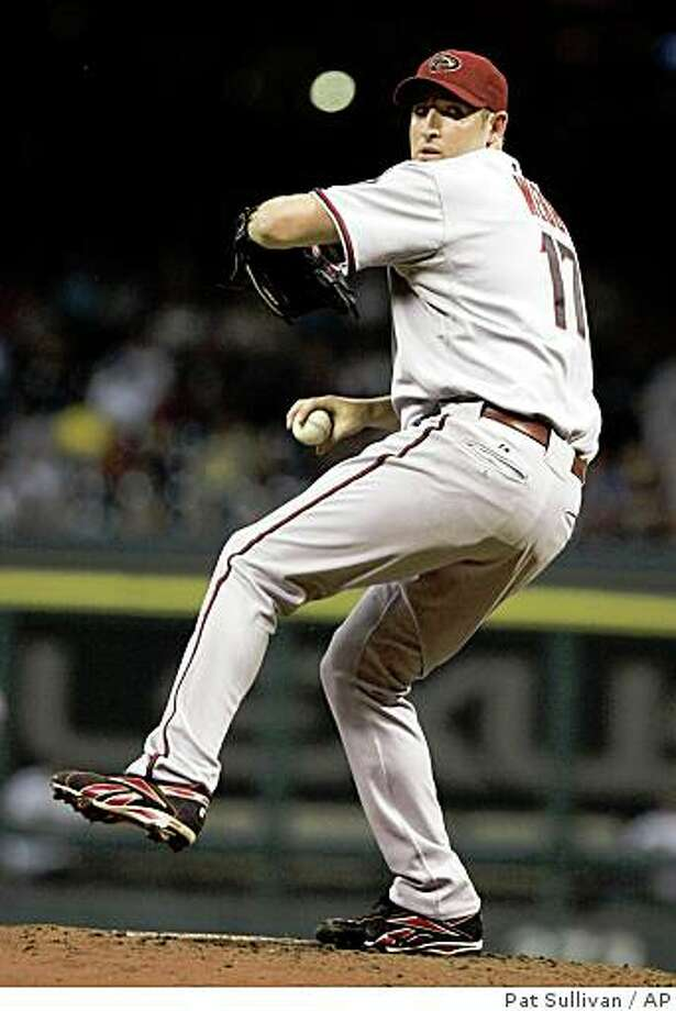 Arizona Diamondbacks starting pitcher Brandon Webb winds up in the second inning against the Houston Astros in a baseball game Friday, Aug. 15, 2008, in Houston. Webb logged his 18th win, giving up two runs, four hits and striking out six in eight innings of the 12-2 rout. (AP Photo/Pat Sullivan) Photo: Pat Sullivan, AP