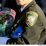 A officer from Las Vegas as thousands of police officers from across the country and Bay Area residents filled the Oracle Arena on Friday March 27, 2009 in Oakland, Calif., for the funeral of four Oakland police officers shot and killed in the line of duty.