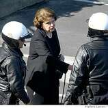 Dianne Feinstein greets two Oakland motorcycle policeman outside of the Oracle Arena on Friday March 27, 2009 in Oakland, Calif., before the funeral of four Oakland police officers shot and killed in the line of duty.
