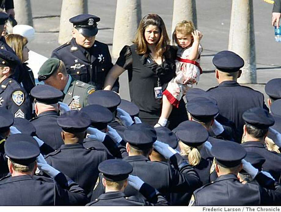 Family members of of slain Oakland police Sgt. Dan Sakai arrive at the Oracle Arena on Friday March 27, 2009 in Oakland, Calif., for the funeral of four Oakland police officers shot and killed in the line of duty. Photo: Frederic Larson, The Chronicle
