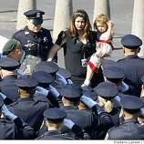 Family members of of slain Oakland police Sgt. Dan Sakai arrive at the Oracle Arena on Friday March 27, 2009 in Oakland, Calif., for the funeral of four Oakland police officers shot and killed in the line of duty.