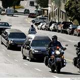 Oakland police motorcycle officers lead the funeral procession for fellow officer John Hege down Pleasant Valley Road in Oakland, Calif., on Friday, March 27, 2009.