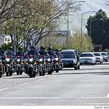 The funeral procession for Oakland police officer Dan Sakai goes down Industrial Boulevard in Hayward, Calif., on Friday, March 27, 2009. Sakai was killed along with three other Oakland police officers.