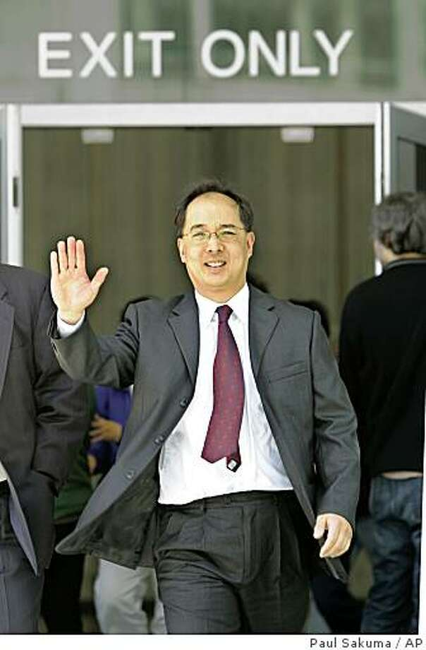 Former San Francisco Supervisor Ed Jew leaves a sentencing hearing at a federal courthouse in San Francisco, Friday, April 3, 2009.  Jew has been sentenced to five years and four months in prison for attempting to shake down small city businesses having planning permit problems. He was ensnared in a 2007 FBI sting that videotaped Jew receiving $40,000 in marked bills from an owner of a Quickly fast-food restaurant. He later pleaded guilty to one count each of bribery, extortion and fraud and admitted he tried to force several Quickly owners to pay him a combined $80,000.  (AP Photo/Paul Sakuma) Photo: Paul Sakuma, AP