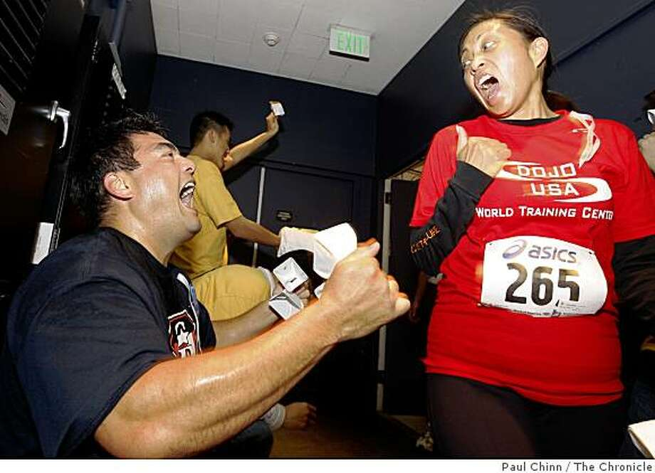 Greg Collaco congratulates Gina Dionda when she reached the top floor 52-story 555 California building after climbing the 1,197 step stairway in San Francisco, Calif., on Saturday, March 28, 2009. Collaco, a San Francisco firefighter, had completed the climb minutes earlier. Photo: Paul Chinn, The Chronicle
