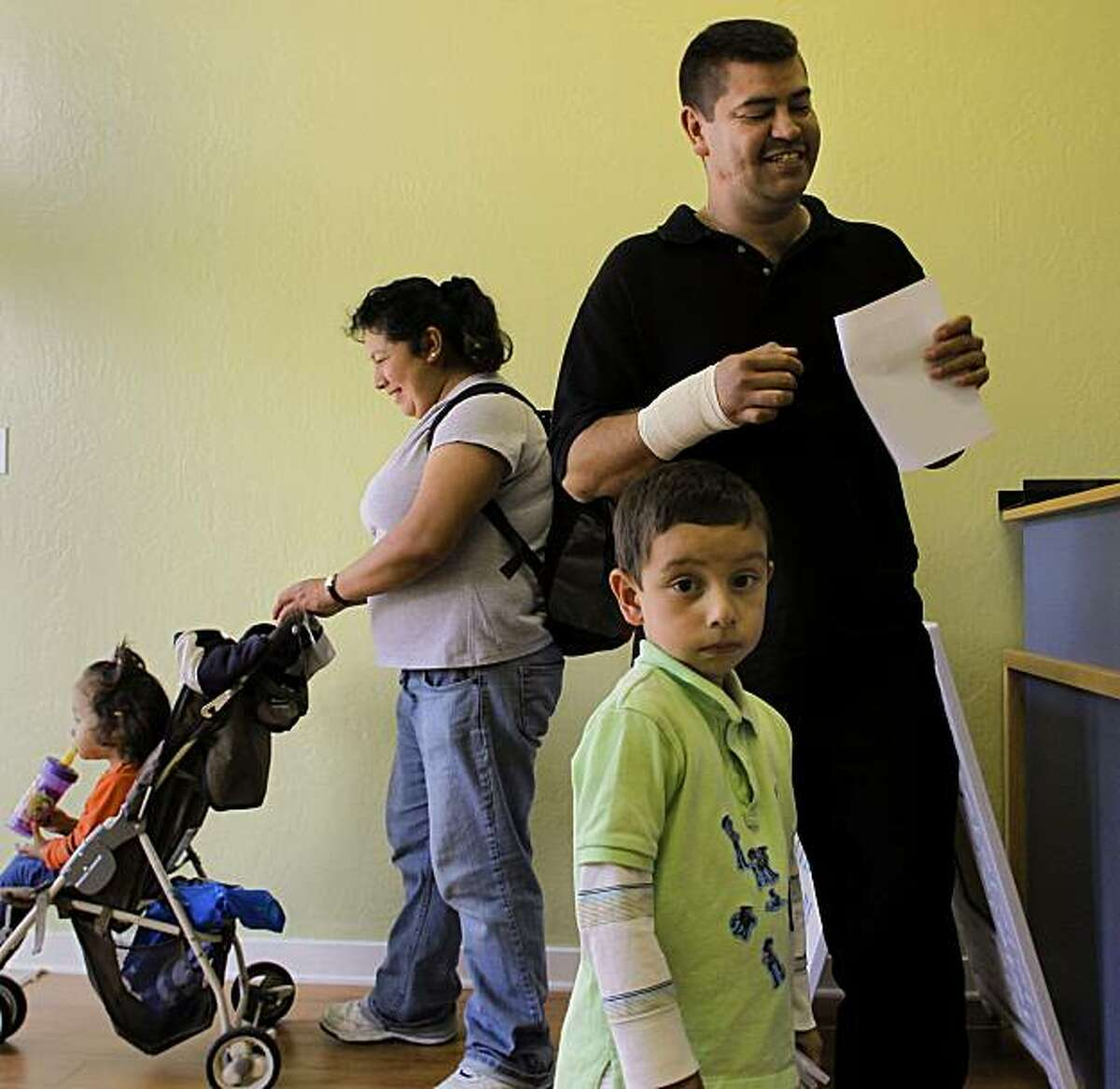 The Lopez family, Rosaure, 2, Aurelia, Sergio, 4, and Juan, who was in for a wrist injury, seeking medical attention at Clinic By The Bay, on Thursday Nov. 4, 2010 in San Francisco, Calif. The first clinic in the Bay Area and only the second in California that is staffed by retired and volunteer doctors and nurses.