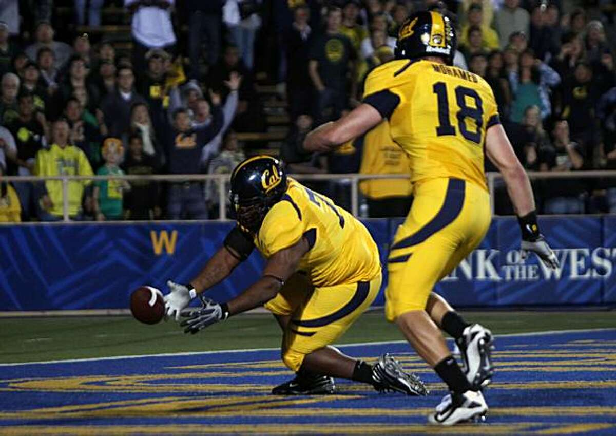 Cal's Derrick Hill falls on the ball in the end zone in the third quarter after stripping it from Ducks quarterback Darron Thomas on Saturday at Memorial Stadium.