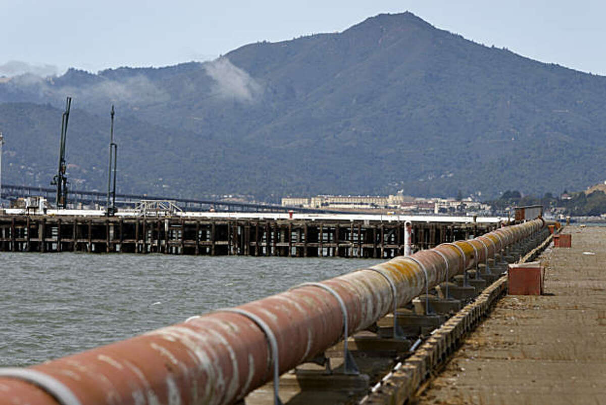 Rusty pipes extend out to the end of a pier at the old Point Molate Naval Supply Center in Richmond, Calif., on Tuesday, Aug. 11, 2009. The Guideville Band of Pomo Indians tribe may use the pier for commuter ferry service if their proposed resort and casino plan is approved.