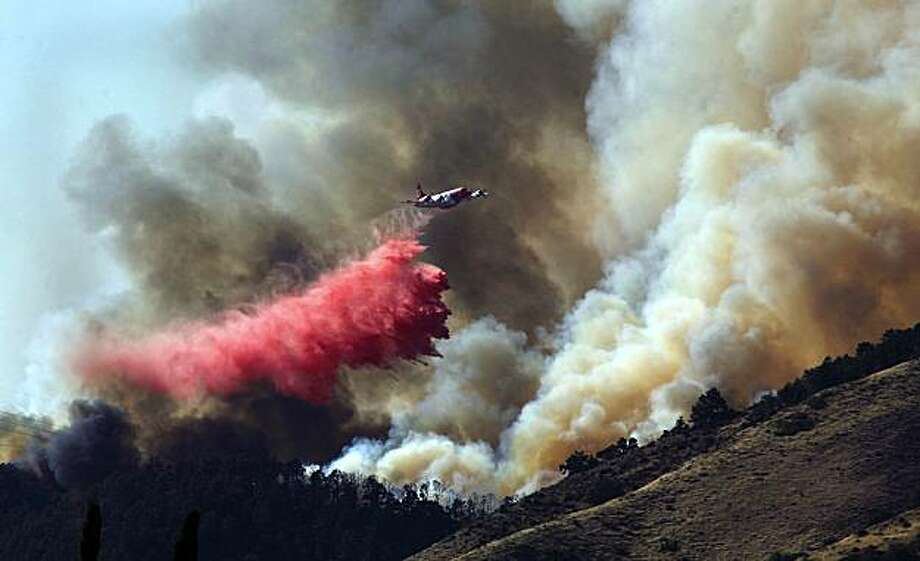 An air tanker makes a fire retardant drop on the south side of the Post Fire, near Frazier Park, Tuesday, Aug.  24, 2010 near Lebec, Calif. on  Tuesday, Aug. 24, 2010. Several helicopters, air tankers, bulldozers were battling the blaze along with firefighters from multiple agencies. Photo: Casey Christie, AP