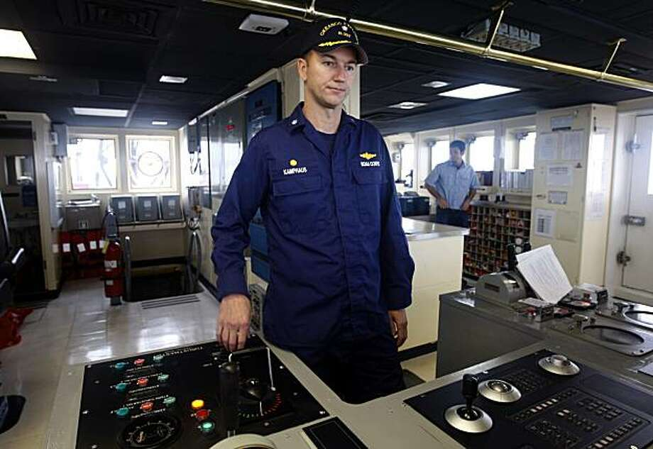 Robert Kamphaus, commander of the NOAA research ship Okeanos Explorer, works on the ships's bridge in San Francisco, Calif., on Saturday, Oct. 30, 2010. Photo: Paul Chinn, The Chronicle