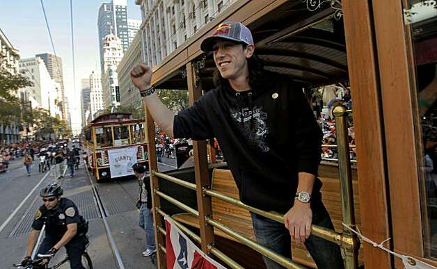 Giants' Tim Lincecum waves to fans along Market Street, as the City of San Francisco celebrates the World Series Champion Giants with a parade down Market Street, on Wednesday Nov. 3, 2010 in San Francisco, Calif. Photo: Michael Macor, San Francisco Chronicle