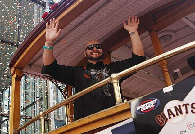 After the San Francisco Giants won the World Series, Cody Ross, waves to fans on during the victory parade on Wednesday Nov. 03, 2010 in San Francisco, Calif. Photo: Mike Kepka, The Chronicle