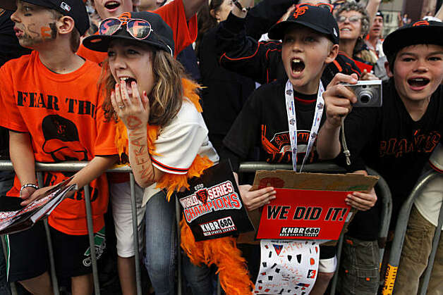 After the San Francisco Giants won the World Series, Rose Trachtenberg, 12, holds back tears as the Giants ride down Market Street during the Victory parade on Wednesday Nov. 03, 2010 in San Francisco, Calif. Photo: Mike Kepka, The Chronicle
