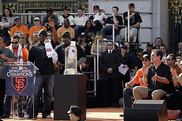 San Francisco Giants manager Bruce Bochy (right) applauds with others as Edgar Renteria (second from left) acknowledges the crowd while standing on stage with Andres Torres (left) and Juan Uribe (third from left) during the ceremony at Civic Center Plaza after the World Series parade celebrating the San Francisco Giants win in the 2010 World Series on Monday, November 3, 2010 in San Francisco, Calif. Photo: Lea Suzuki, San Francisco Chronicle