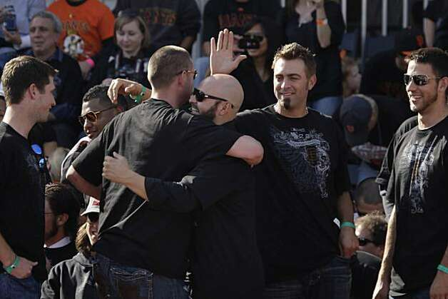 San Francisco Giants' Aubrey Huff and Cody Ross hug as Huff returns to his seat after speaking at the ceremony at Civic Center Plaza after the World Series parade celebrating the San Francisco Giants win in the 2010 World Series on Monday, November 3, 2010 in San Francisco, Calif. Photo: Lea Suzuki, San Francisco Chronicle