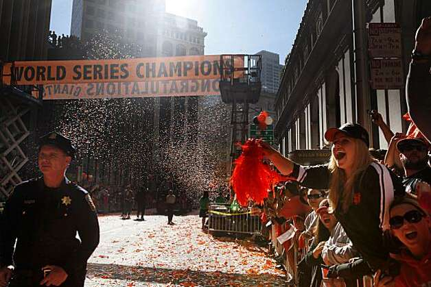 After the San Francisco Giants won the World Series, Police and fans bare witness to a ticker tape parade at the corner of Market and Montgomery Streets on Wednesday Nov. 03, 2010 in San Francisco, Calif. Photo: Mike Kepka, The Chronicle