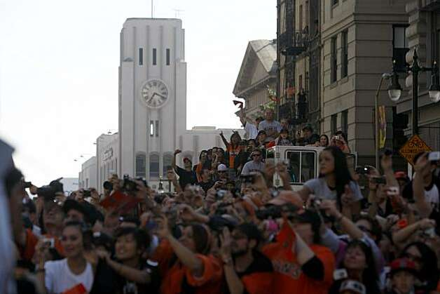 After the San Francisco Giants won the World Series, with the San Francisco Chronicle office in the background, fans watch the victory parade at 5th and Market Streets on Wednesday Nov. 03, 2010 in San Francisco, Calif. Photo: Mike Kepka, The Chronicle