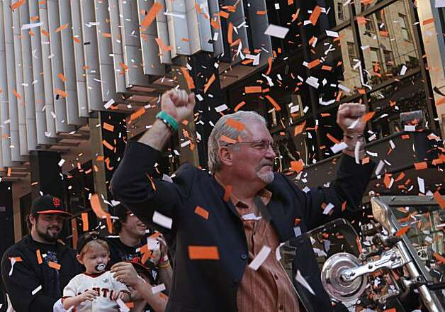 After the San Francisco Giants won the World Series, Giants General Manager, Brian Sabean, cheers with fans as he comes down Montgomery Street during a ticker take victory parade on Wednesday Nov. 03, 2010 in San Francisco, Calif. Photo: Mike Kepka, The Chronicle