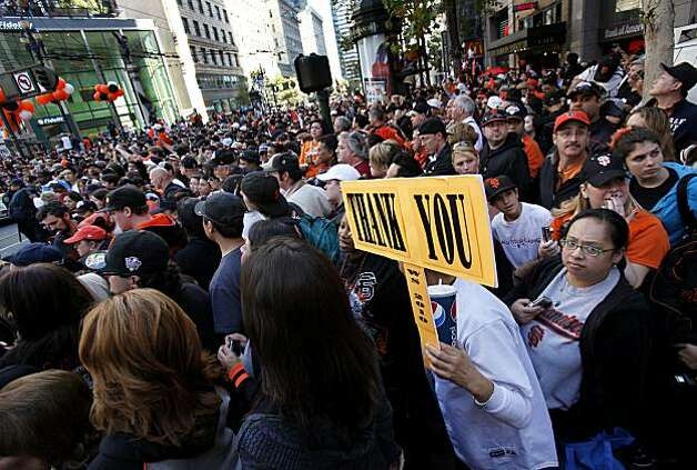 The crowd at the east end of the parade route was twenty deep Wednesday November 3, 2010. Thousands of San Francisco Giant fans attended a parade in downtown San Francisco, Calif. celebrating the teams World Series victory. Photo: Brant Ward, The Chronicle
