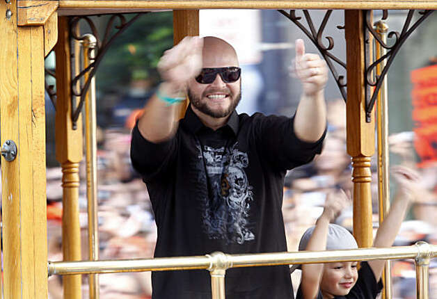 Cody Ross thanked the crowd for their support Wednesday November 3, 2010. Thousands of San Francisco Giant fans attended a parade in downtown San Francisco, Calif. celebrating the teams World Series victory. Photo: Brant Ward, The Chronicle
