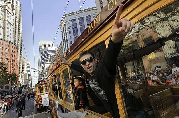 Giants' Freddy Sanchez waves to fans along Market Street, as the City of San Francisco celebrates the World Series Champion Giants with a parade down Market Street, on Wednesday Nov. 3, 2010 in San Francisco, Calif. Photo: Michael Macor, San Francisco Chronicle
