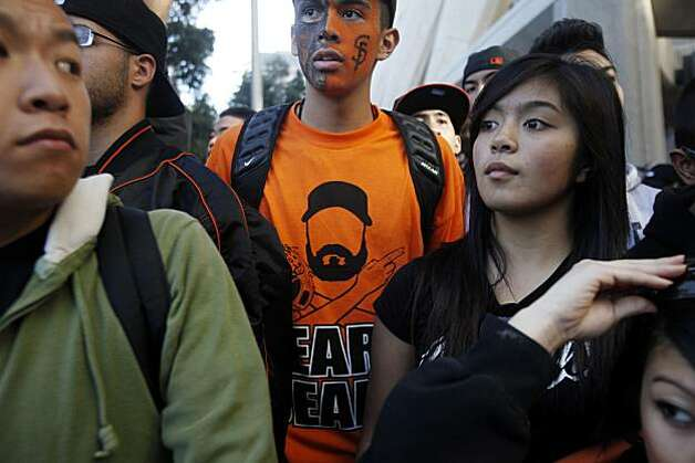 After the San Francisco Giants won the World Series, Bryan Fletes, 16, of Daly City, anxiously awaits the start of the victory parade at  Washington and Montgomery Streets on Wednesday Nov. 03, 2010 in San Francisco, Calif. Photo: Mike Kepka, The Chronicle