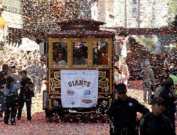 Confetti was in good supply as the parade made its way down Montgomery Street Wednesday November 3, 2010. Thousands of San Francisco Giant fans attended a parade in downtown San Francisco, Calif. celebrating the teams World Series victory. Photo: Brant Ward, The Chronicle