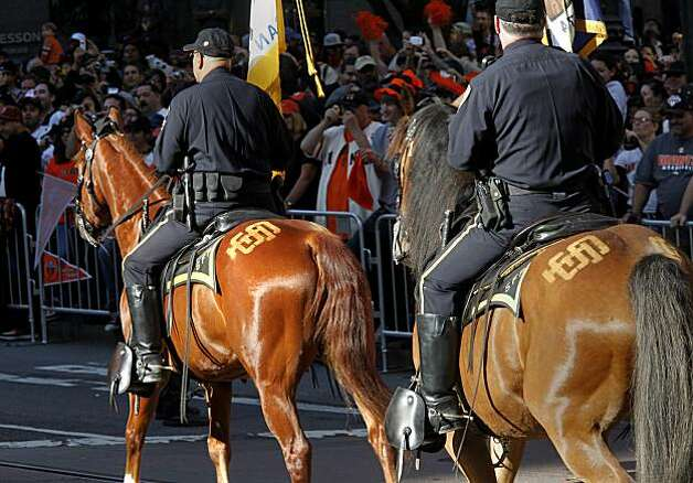 Even the San Francisco police mounted patrol had the SF logo on their rear ends. Thousands of San Francisco Giant fans attended a parade in downtown San Francisco, Calif. celebrating the teams World Series victory. Photo: Brant Ward, The Chronicle