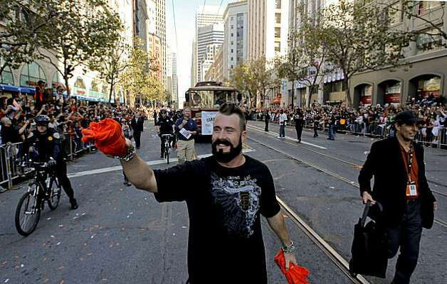 Giants' pitcher, Brian Wilson smiles and waves to fans as he throws tee shirts along MArket Street, as the City of San Francisco celebrates the World Series Champion Giants with a parade down Market Street, on Wednesday Nov. 3, 2010 in San Francisco, Calif. Photo: Michael Macor, San Francisco Chronicle