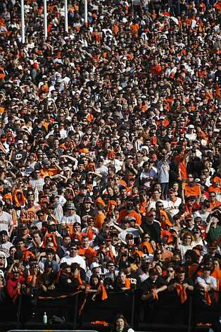 After the San Francisco Giants won the World Series, thousands of fans watch from Civic Center Plaza as players and coaches make an appearance at City Hall on Wednesday Nov. 03, 2010 in San Francisco, Calif. Photo: Mike Kepka, The Chronicle